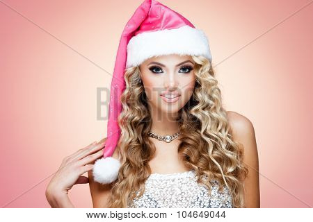 Young lady in Christmas hat on white background