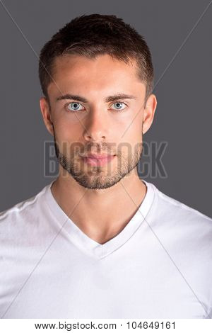 Attractive man wearing a white tshirt