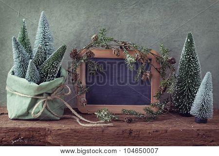 Retro christmas decoration and wooden empty blackboard