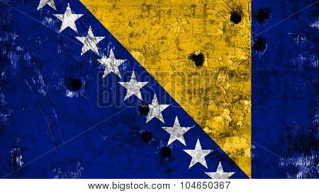 Bosnia and Herzegovina flag painted on wall with bullet holes