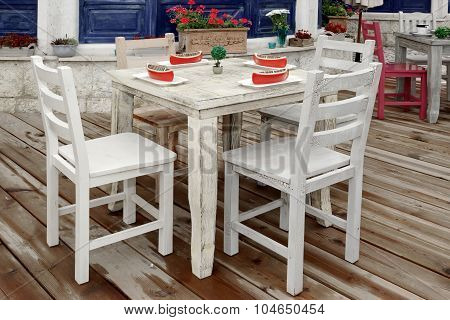 Vintage Wooden Dining Table And Chairs On Wood Patio Floor