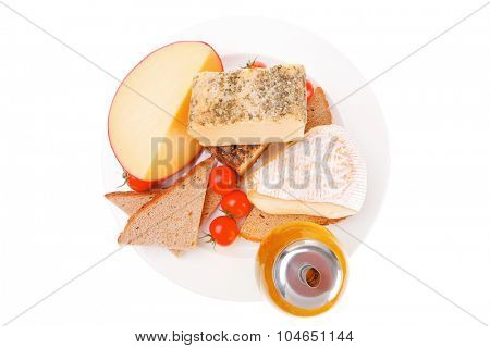 french aged cheeses on dish with bread and tomatoes