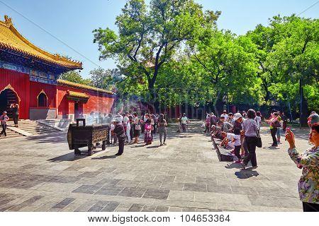 Beijing, China - May 20, 2015: People Walk, Pray In Lama Temple Area, Beijing. Yonghegong  Lama Temp