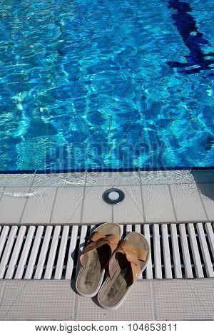 Flip Flops Beside Blue Pool