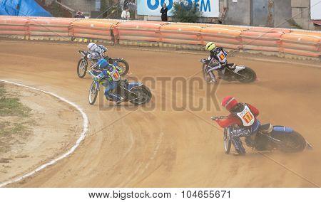 Motorcycle Racers Enter Turn