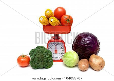 Kitchen Scales And Fresh Vegetables Isolated On White Background