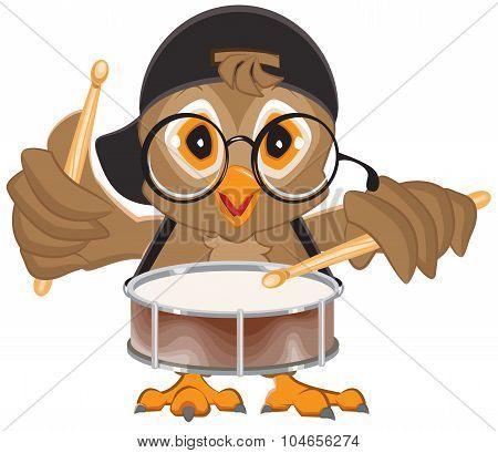 Owl drummer. Owl beats the drum