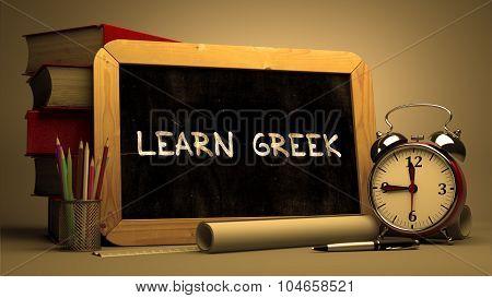 Hand Drawn Learn Greek Concept on Chalkboard.