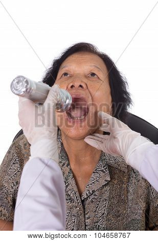Doctor Checking Senior Woman For Sore Throat