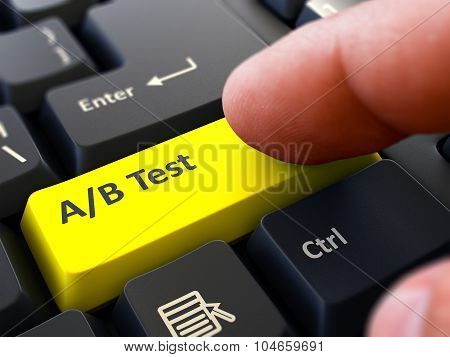 AB Test - Concept on Yellow Keyboard Button.