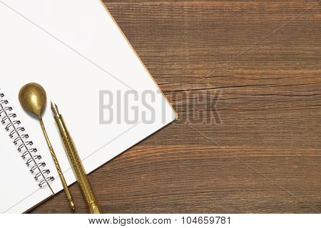 Notebook With Blank Page, Spoon And Pen  On Wood Table
