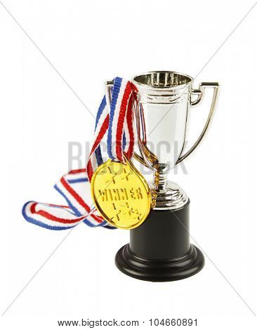 Medal and trophy on white background