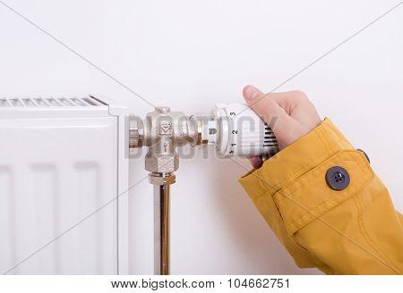Female Hand Adjusting Heater
