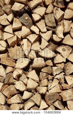 Large Woodpile From Chopped Firewood Background