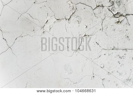 old crack and grunge stucco white wall on vintage house