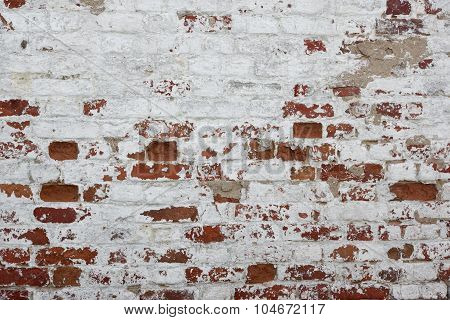 Red Brick Wall With Damaged White Plaster Background
