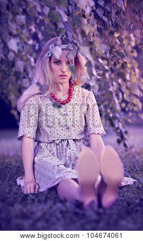 Beautiful woman under birch tree, outdoors, people