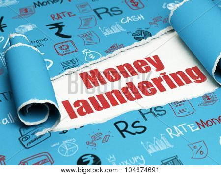 Banking concept: red text Money Laundering under the piece of  torn paper