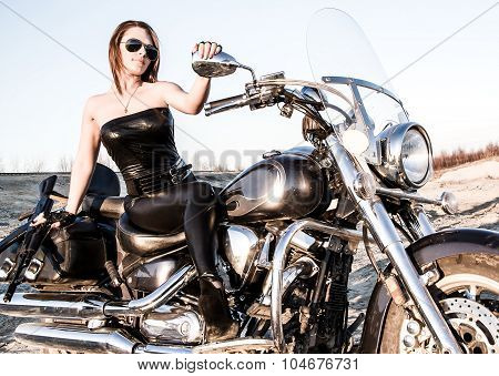 Sexy Woman In A Leather Clothes Sitting On A Bike