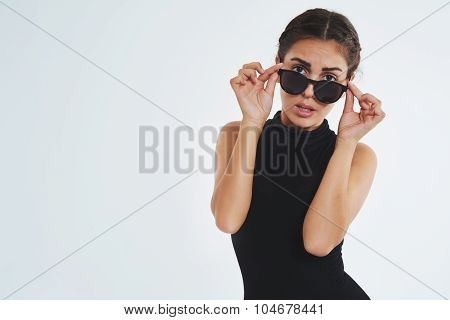 Sexy Young Woman Looking Over Her Sunglasses