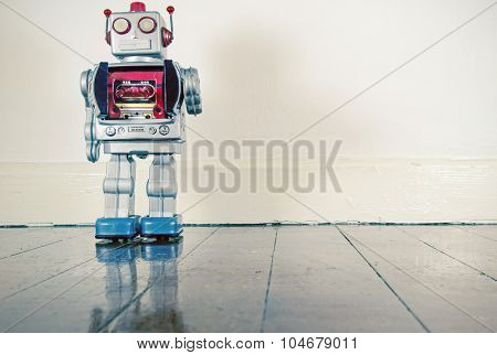 retro robot on old wooden floor