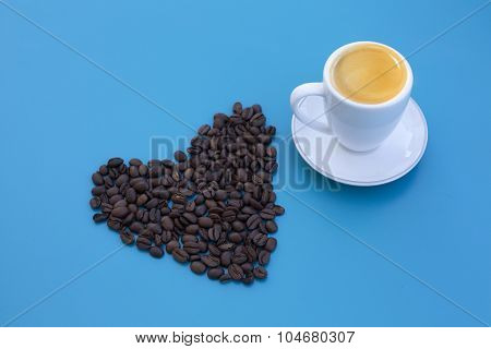 Heart Shape Of Coffee Beans With Cup Of Coffee