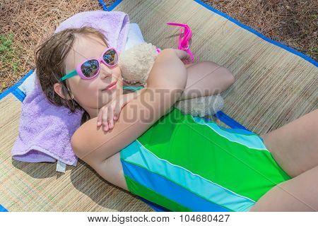 Little girl lying on the plaid
