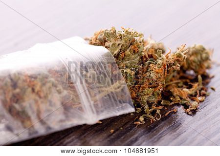 Close Up Dried Marijuana Leaves On The Table