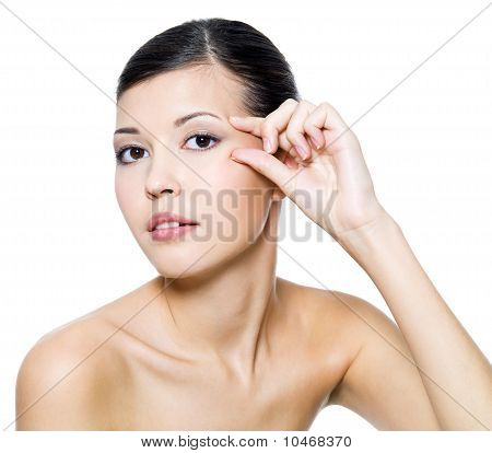 Beautiful Woman Touching Skin Around The Eyes