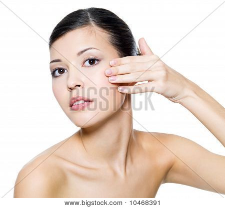 Woman Touching  Skin On Cheek