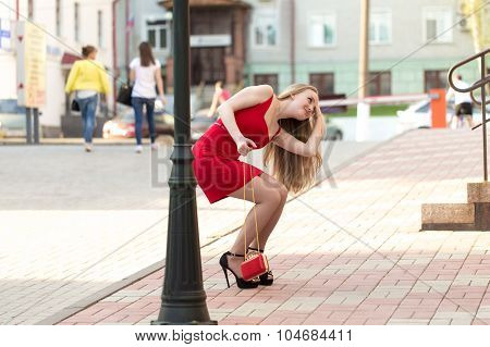 The girl in the red dress on the street