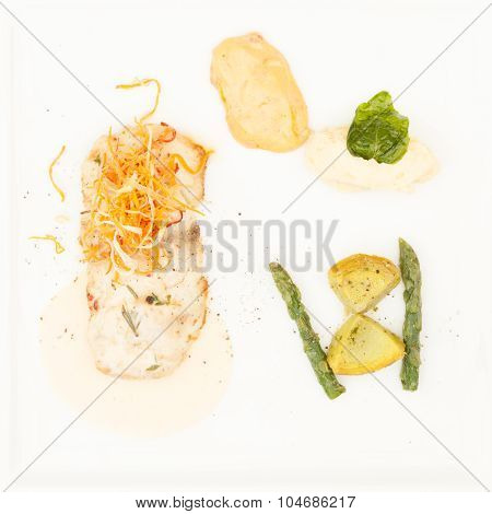Fillet Of Sea Bass Provancale, With Asparagus And Cream Sauce