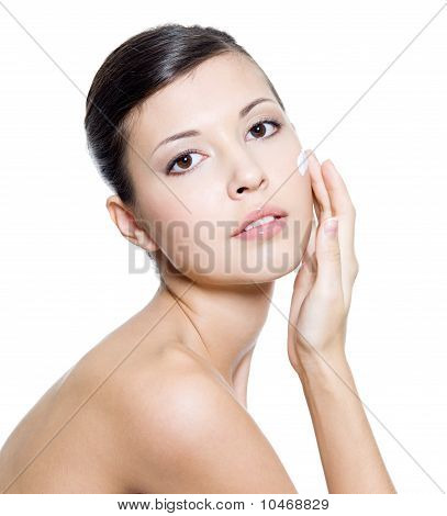 Beautiful Woman Applying Cosmetic Cream On Face