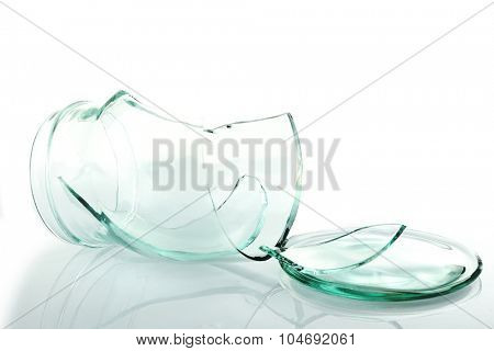 Shattered glass jar isolated on white