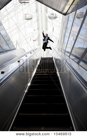 Happy businessman and Escalator