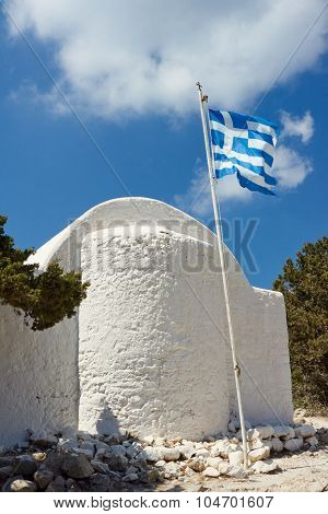 Orthodox chapel and a mast with the Greek flag