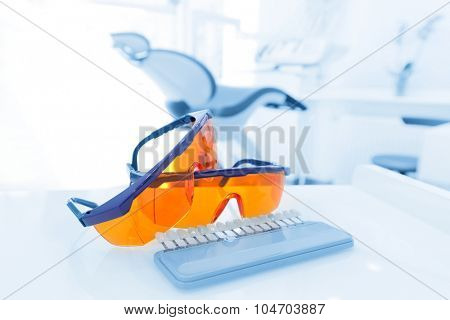 Equipment and dental instruments in dentist's office. Googles, tools close-up. Dentistry
