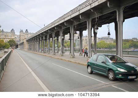 PARIS, FRANCE - SEP 11, 2014: Bir-Hakeim Bridge is the unique two-tiered bridge. Top level for subway trains and the bottom is for cars and pedestrian