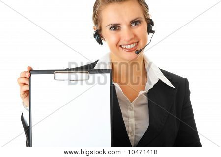 smiling modern business woman with headset and blank clipboard
