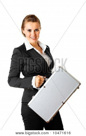 Smiling modern business woman holding suitcase in hands