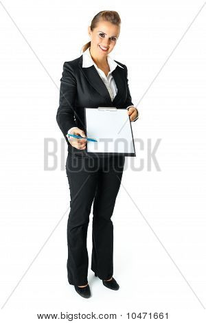 Full length portrait of friendly modern business woman with documents and pen for your sign