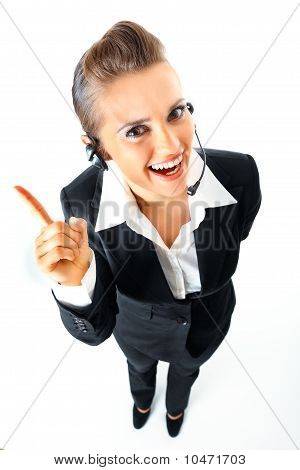 Full length portrait of friendly telephone operator with headset