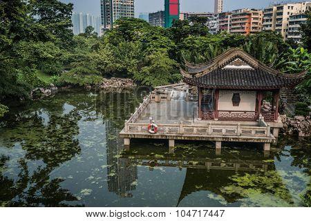 pagoda temple by pond at Kowloon Walled City Park in Hong Kong