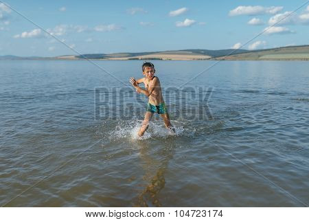 Boy In Very Cold Water