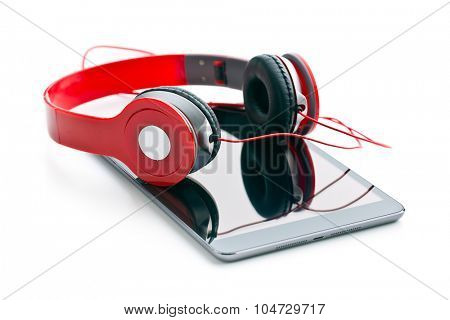 computer tablet with headphones on white background