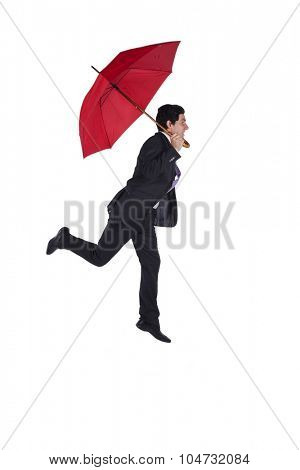 Businessman flying with a red umbrella