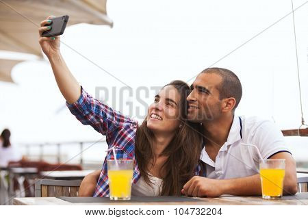 Happy couple at the bar making selfies