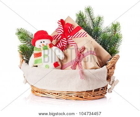 Christmas gift boxes, snowman toy, fir tree in basket. Isolated on white background