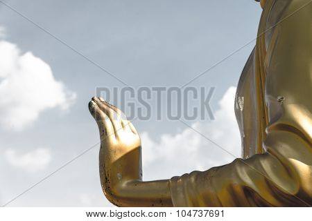 Golden Buddha Hand On 'o.k.' Sign (peace) With Blue Sky And Clouds Closeup Focused On  Hand Pastel T