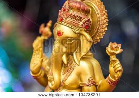 Golden Ganesha Elephant God In Hiduism Hold Axe And Lotus Pose